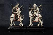 An exceptional pair of Chinese 19th century carved ivory fig