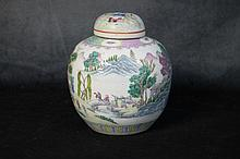 A Chinese porcelain lidded vase with figure in landscape dec