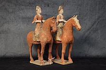 A fine pair of Chinese terracotta figures of the men on hors
