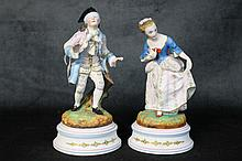 A pair of porcelain figures of the baby and gent. Height 21c