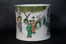 A large Chinese porcelain brush pot with hand painted figure