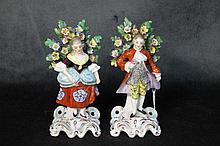 A pair of porcelain figures by the trees. Height 16cm, Width