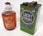 1 gallon Lucky Strike Cow Spray tin and 1 gallon glass DeLaval oil jug with contents