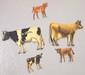 Tin DeLaval cows & calves: Holstein cow & calf, Guernsey cow & calf, Brown Swiss calf