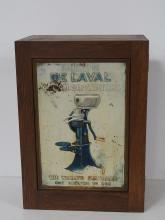 DeLaval parts cabinet w/ tin sign in door