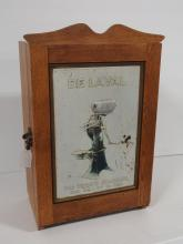 Oak DeLaval parts cabinet w/ tin sign in door