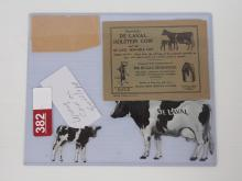Tin DeLaval Holstein cow & calf set w/ envelope