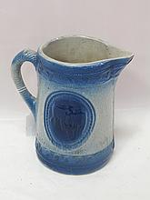 Early crock pitcher with embossed cows