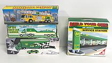 (4) NIB BP toys: 1993 Race Car Carrier with F-1 Racer, 1999 Fire Engine, Racing Transport Truck & Build Your Own Service Station
