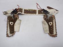 Decorated holster set with Cowboy Jr Cap Pistols