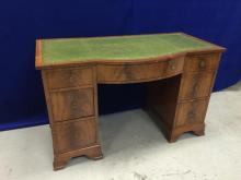 Old English regency style mahogany desk with green leather top