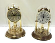 Two very nice glass dome Anniversary clocks, one with Swarovski crystals!