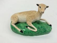 Antique ceramic lamb on grass, Dresden or Staffordshire?