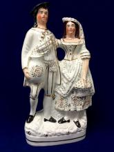 Staffordshire figural couple on oval base with gilt line in front only, c. mid 19th century
