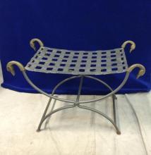 Metal garden bench with brass duck head finals