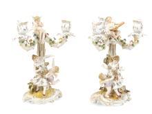 A pair of German porcelain candelabra