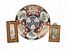 An Oriental polychromatic painted plate with two plaques