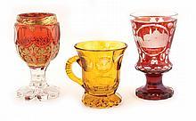 A set of three Bohemian glasses