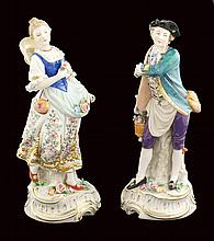 A pair of Capodimonte porcelain figures