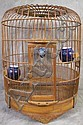 OLD CHINESE WOODEN BIRDCAGE.  Early 20th century.  With blue and white porcelainfeeders.  16 1/4