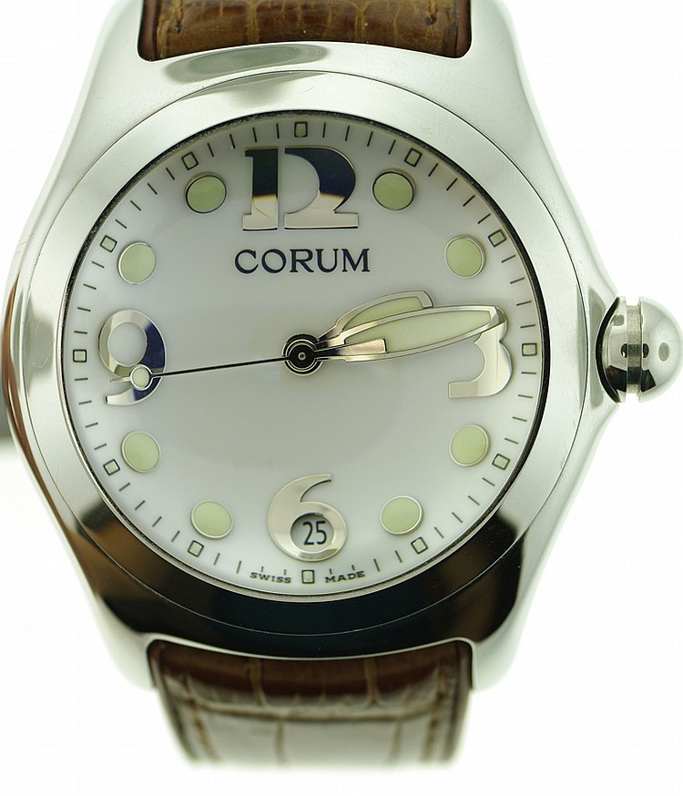 """CORUM"" BUBBLE WATCH. Pre-owned. With leather strap in the original box. Stainless steel case and buckle."