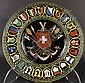 CONTINENTAL POLYCHROME CERAMIC CRESTED CHARGER.  Center with shield, pole arms and banner having inscription