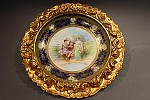 ROYAL VIENNA PLATE WITH GILT FRAME. 12