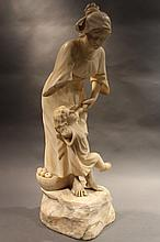 MARBLE SCULPTURE OF WOMAN AND CHILD.