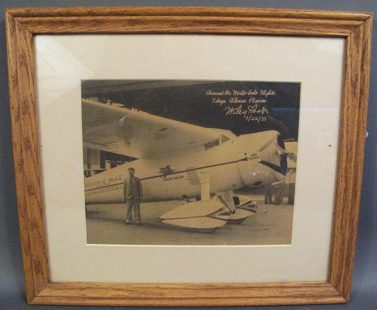 WILEY POST ORIGINAL 1933 PRINT OF FAMED AVIATOR WITH WINNIE MAE-HIS AIRPLANE.  (Note:  he was lost over the Pacific with Amelia Earhart).
