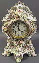 FRENCH PORCELAIN SHELF CLOCK.  Mounted with putti and flowers.  15