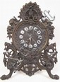 AMERICAN PATINATED ORNATE CAST IRON CLOCK. With