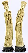 PAIR OF DECORATIVE RESIN REPLICAS OF IVORY