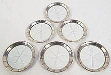 SIX STERLING SILVER RIM COASTERS.  Star cut glass bottoms.  3 5.8