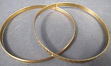 TWO 18K GOLD BANGLE BRACELETS.  3/16