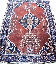 TURKISH AREA SIZE ORIENTAL RUG.  Blue patterned border with rust field and a cen