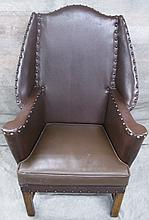 ANTIQUE ENGLISH PROVINCIAL COUNTRY WING CHAIR.  Quaint styling and modern leathe
