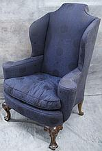 AMERICAN COLONIAL STYLE WING CHAIR.  Carved queen ann feet, sound upholstery.