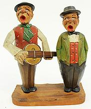 GERMAN CARVED BAR ROOM SINGERS CORKSCREW AND BOTTLE CAP LIFTER UNDER HEADS.  Ca.