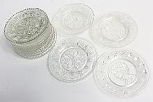 12 LACY PRESSED FLINT GLASS CUP PLATES.  All different patterns.  Average is 3 1