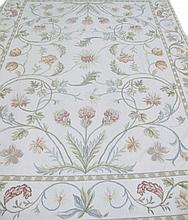 HANDMADE NEEDLEPOINT RUG.  All over scrolling stems with leaves and flower heads