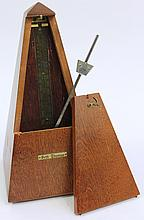 SETH THOMAS METRONOME.  Mahogany case and clock work mechanism.  9