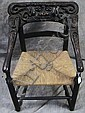 UNUSUAL AMERICAN FOLK ART CARVED ARMCHAIR.  19th century.  Back with face, arms with faces with open mouth and bird claw posts.  28