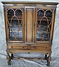 DEPRESSION ERA WALNUT CHINA CABINET. With two
