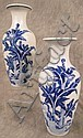 PAIR OF JAPANESE BLUE AND WHITE PORCELAIN VASES.  19th century.  Signed.  8