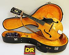 ORPHEUM MANDOLIN.  Model M-30.  8 paired strings, exotic hardwoods with spruce t op, pearl inlaid head.  (Note:  like new condition with fitted case).