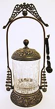 VICTORIAN SILVERPLATE PICKLE JAR ON FRAME.  Pair of tongs go along with.  (Note: jar engraved with foliage and birds).  11