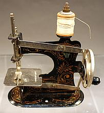 MINI TOY SEWING MACHINE.  With floral decals.  5