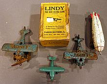 FIVE METAL VINTAGE TOY AIRPLANES.  Cast iron and steel.  Including Hubley.