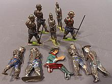 TEN PRESSED TIN TOY SOLDIERS.