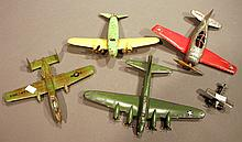 FOUR CAST IRON AND PRESSED STEEL AIRPLANES.  Including one blimp,Lindy (Hubley) and a Lindy